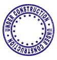 grunge textured under construction round stamp vector image vector image