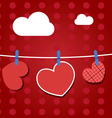 Paper hearts hanging from a rope on red wallpaper vector image vector image