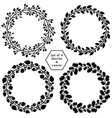 set of 4 wreaths with black barries and leaves vector image