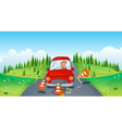 A red car at the road bumping the traffic cones vector image