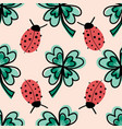 clover leaves and ladybugs seamless vector image