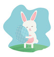 cute rabbit with easter egg painted in the vector image vector image
