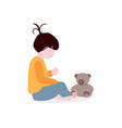 girl playing with teddy bear flat vector image