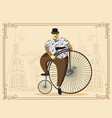 man on penny farthing bicycle on old city vector image vector image
