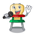 singing cartoon baby sitting in the highchair vector image vector image