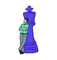 businessman standing with big blue chess vector image vector image