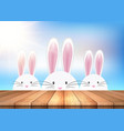 easter background with bunnies looking over a vector image vector image