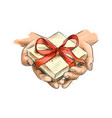 female hands holding a small gift wrapped with red vector image vector image