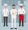 chef and two cook in uniform standing together vector image vector image