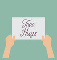 hands holding a free hugs sign vector image vector image