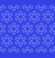 seamless snowflakes background on dark blue vector image vector image