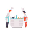 two chefs in uniform cookong some food in the tv vector image
