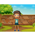 Boy standing in the yard vector image vector image