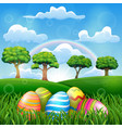 easter egg on the grass field with a rainbow backg vector image vector image