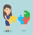 businesswoman completing lightbulb made of puzzle vector image vector image