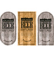 label beer with the old town on wooden background vector image vector image