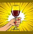 pop art woman hand hold red wine glass vintage vector image vector image