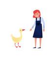 girl standing next to goose female farmer taking vector image vector image