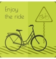 Gray shape bicycle on the road with road sign vector image
