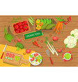 table with fresh organic vegetables and cooking vector image
