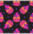 sweet seamless pattern with cupcakes on a black vector image