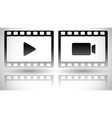 set of filmstrips with play and camera symbols vector image