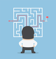 Businessman standing in front of a maze vector image