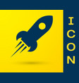 blue rocket ship with fire icon isolated on yellow vector image vector image