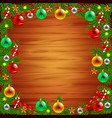 Christmas tree branches around the wood background vector image vector image