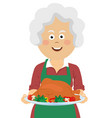 elderly woman with thanksgiving turkey vector image vector image