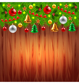 Christmas tree branches on wood background vector image