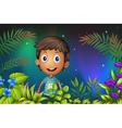 A boy smiling in the garden vector image vector image