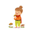 beautiful little girl in warm clothing collecting vector image vector image