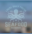 seafood emblem with octopus on blured background vector image