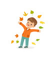 cute little boy throwing colorful autumn leaves up vector image
