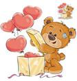 a teddy bear opens a box vector image