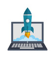 laptop computer with startup rocket isolated icon vector image