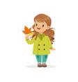 sweet little girl in in green coat holding vector image vector image