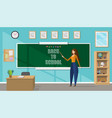 young female teacher in a classroom vector image vector image