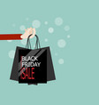 hand with shopping bag in black friday sale vector image