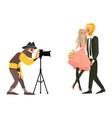 photographer shooting a wedding couple vector image vector image