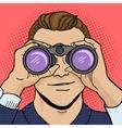 Businessman looks through binocular pop art vector image