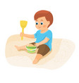 boy playing with sand vector image