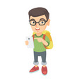 caucasian boy with backpack pointing at cellphone vector image vector image