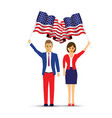 couple waving usa flags vector image