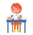redhead schoolboy sitting at table pile of books vector image vector image