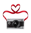 camera and red ribbon with heart vector image vector image