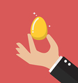 hand with golden egg vector image vector image