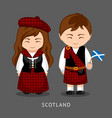scots in national dress with a flag vector image vector image