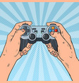 pop art man holding gamepad console vector image